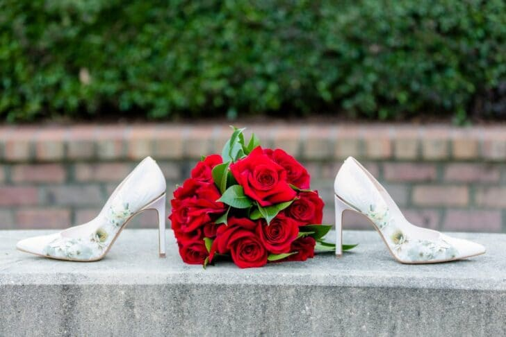 red rose bouquet and wedding shoes
